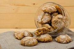 Glass jar with Italian cookies amaretti dropped out Stock Photo