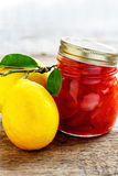 Glass jar of jam of quince and lemon. Stock Photos