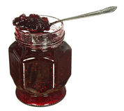 Glass jar of jam and spoon Royalty Free Stock Photography