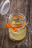 Glass jar with lemon and ice. Royalty Free Stock Image