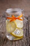 Glass jar with lemon and ice. Stock Photo