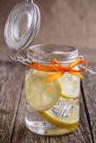 Glass jar with lemon and ice. Stock Photos