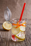 Glass jar with lemon and ice. Royalty Free Stock Images