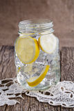 Glass jar with lemon and ice. Stock Images