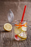 Glass jar with lemon and ice. Stock Photography