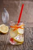 Glass jar with lemon and ice. Stock Image