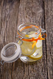 Glass jar with lemon and ice. Royalty Free Stock Photos
