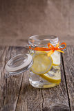Glass jar with lemon and ice. Royalty Free Stock Photography