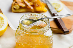 Glass jar of lemon jam on the table Stock Photos
