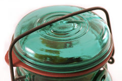 Glass Jar Lid. A close shot of the lid of a green glass mason jar isolated against a white background Royalty Free Stock Photo