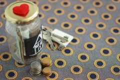Money jar with house keys stock photo