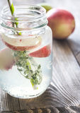 Glass jar of lime water with slices of peach stock images