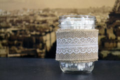 Glass jar with linen cloth. And vintage background royalty free stock image