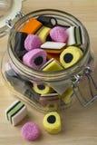 Glass jar with Liquorice allsorts. Glass jar with colorful Liquorice allsorts Stock Images
