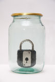 Glass jar with lock Royalty Free Stock Photo