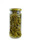 Glass jar with marinated capers fruits Stock Photo
