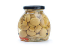 Glass jar with marinated champignons Royalty Free Stock Image