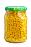 Glass jar with marinated corn grains Royalty Free Stock Image