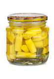Glass jar with marinated courgette Stock Images