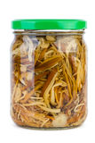Glass jar with marinated enokitake mushrooms Royalty Free Stock Photos