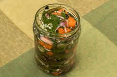 Glass jar with marinated vegetables Stock Photos