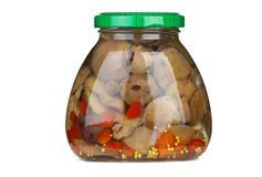 Glass jar with marinated suillus mushrooms Royalty Free Stock Photography