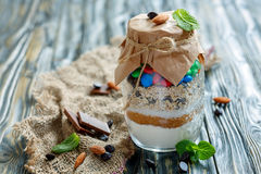 Glass jar with a mixture for making oatmeal cookies. Stock Image