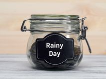 Glass jar with money stock image