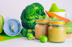 Glass jar with natural baby food on the table Stock Photography