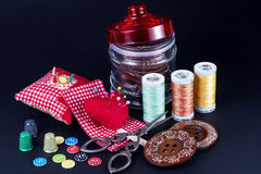 Glass Jar, Neddle Case, Spools, Buttons, Scissors and Thimbles Royalty Free Stock Photo