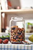 A glass jar nut Royalty Free Stock Photography