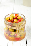 Glass jar with olives and peppers Stock Image