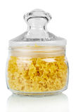 Glass jar with pasta covered   lid isolated on  white background. Stock Photos