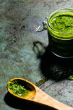 Glass jar of pesto sauce Stock Photo