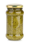Glass jar with pesto sauce Royalty Free Stock Images