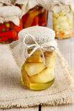 Glass jar of pickled mushrooms on wooden table Royalty Free Stock Photo