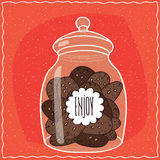 Glass jar with pile of chocolate cookies inside Royalty Free Stock Photography