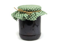 Glass jar of plum jam Stock Image