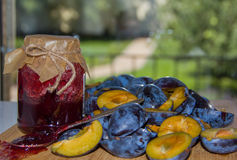 Glass jar with plum jam homemade and fresh plums Royalty Free Stock Photos