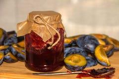 Glass jar with plum jam homemade and fresh plums Stock Photos