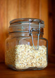 Glass jar of porridge oatmeal Royalty Free Stock Images