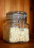 Glass jar of porridge oatmeal. Natural porridge in a glass sealed jar Royalty Free Stock Images