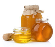 Glass jar and pot of honey with stick Royalty Free Stock Photo