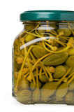 Glass jar of preserved capers Stock Photo