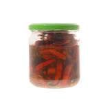 Preserved chili peppers. Glass jar of preserved chili peppers isolated on a white background Stock Photography