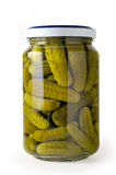 Glass jar of preserved cucumbers Stock Image