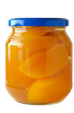 Glass jar of preserved peaches Stock Photography