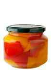 Glass jar of preserved peppers Royalty Free Stock Image