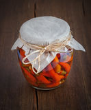 Glass jar with preserved peppers.Homemade tinned or canned food Royalty Free Stock Photos