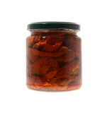 Preserved tomatoes. Glass jar of preserved sun-dried tomatoes isolated on a white background Stock Photos
